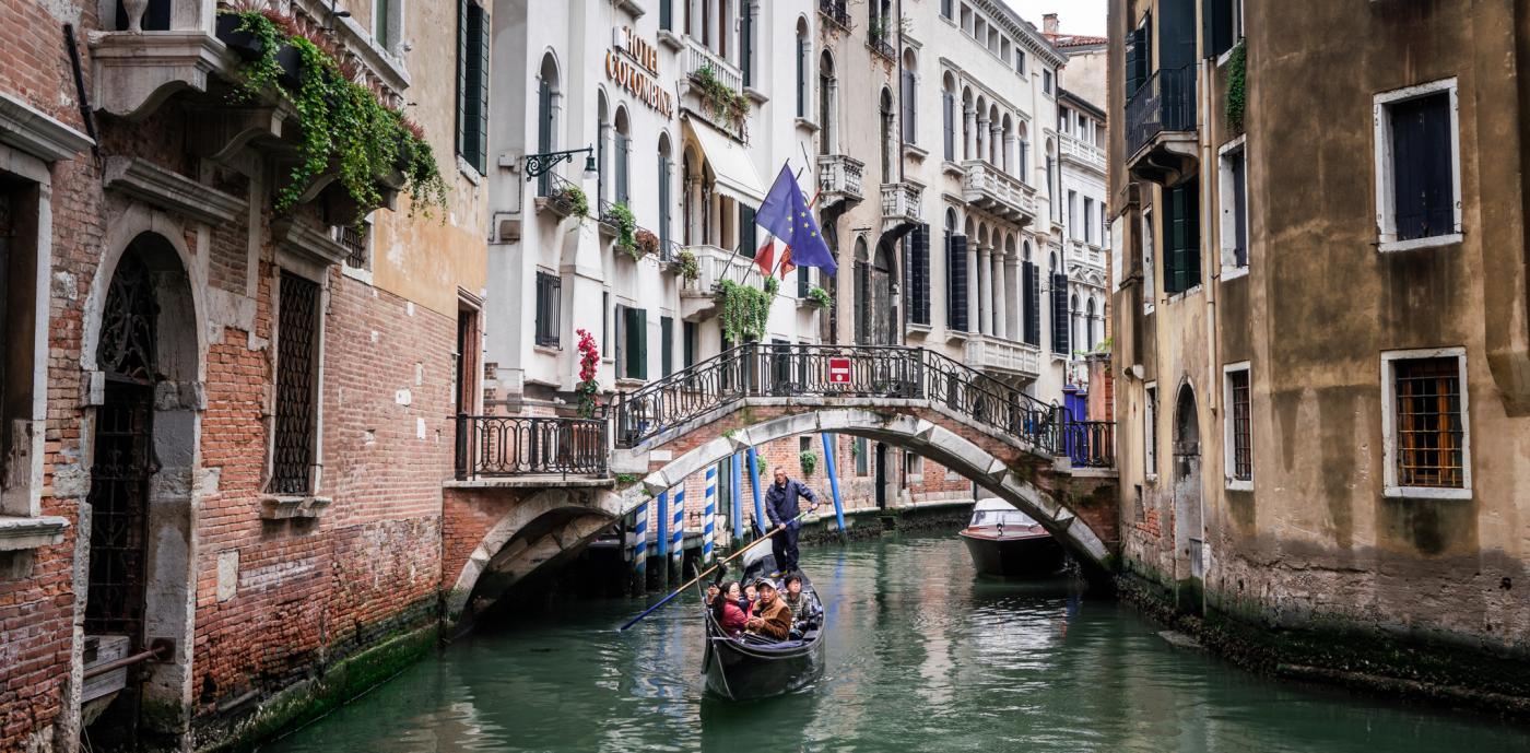 Boat under bridge Venice_Krugman.jpg