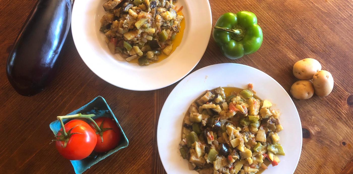 ciaki chukka in dish with potatoes, eggplant, peppers, tomatoes