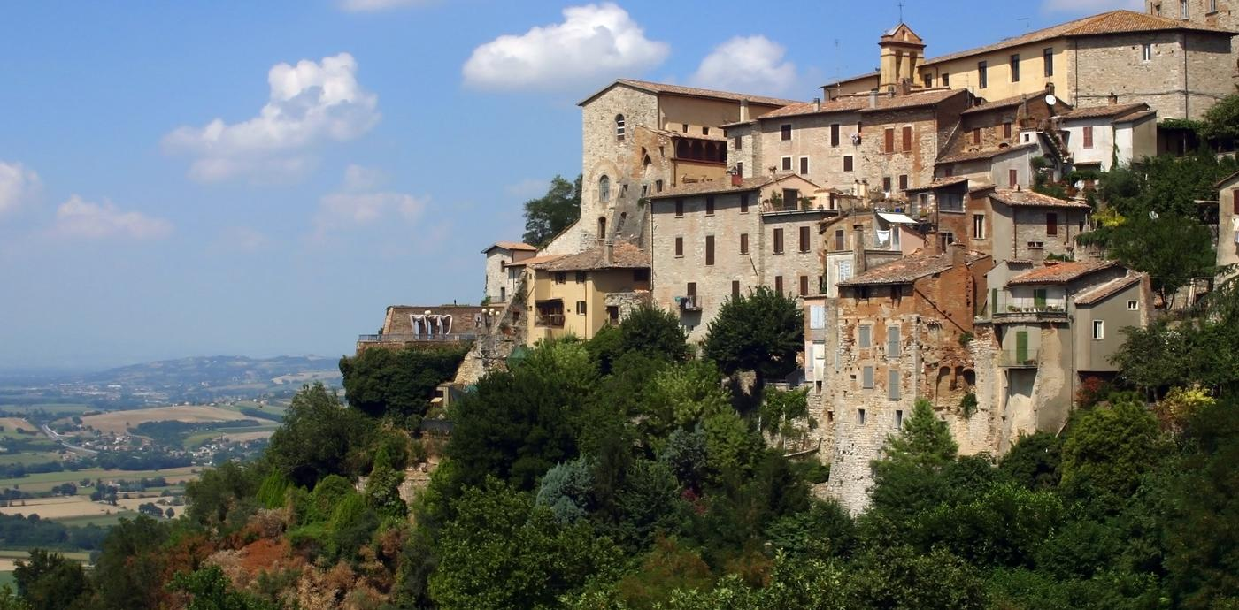 Umbria hillside with buildings and blue sky