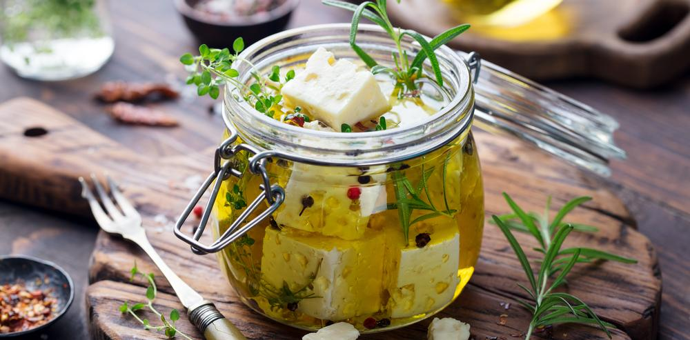 marinated feta cheese in olive oil with herbs and spices