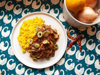 chicken yassa dish with blue patterned background