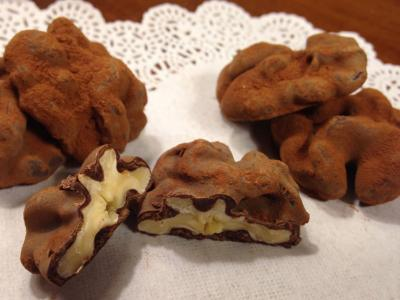 Cut-away view of walnuts covered in chocolate