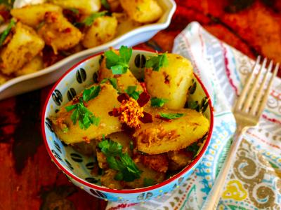 Potatoes with Indian spices in a dish with cilantro