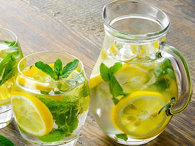Pitcher and Glass of Water with Lemon and mint
