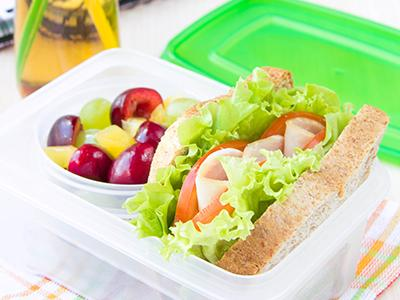 Sandwich and fruit in container
