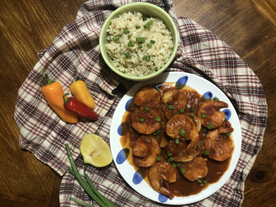 shrimp creole with rice and peppers on printed napkin