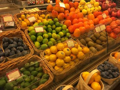 Variety of colorful citrus fruits at a market