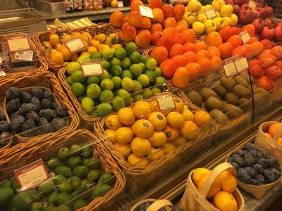 Variety of colorful citrus fruits at a market
