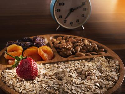 breakfast grains, dried fruit and clock istock