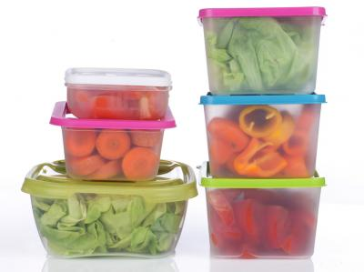 Colorful fruit and vegetables in plastic containers