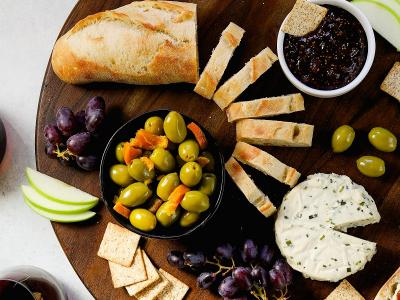 sweet and spicy cheese plate with olives and jam