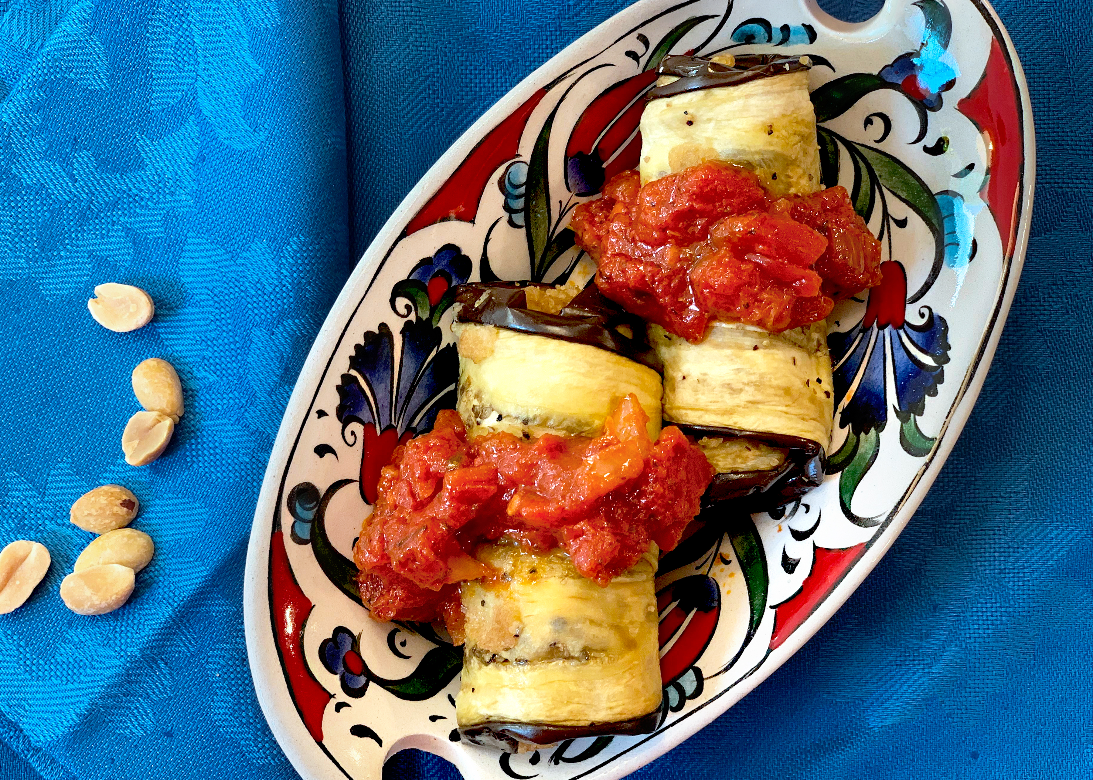 eggplant rollups topped with tomato sauce