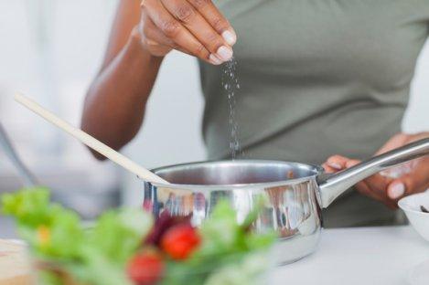 Woman Salting Pot