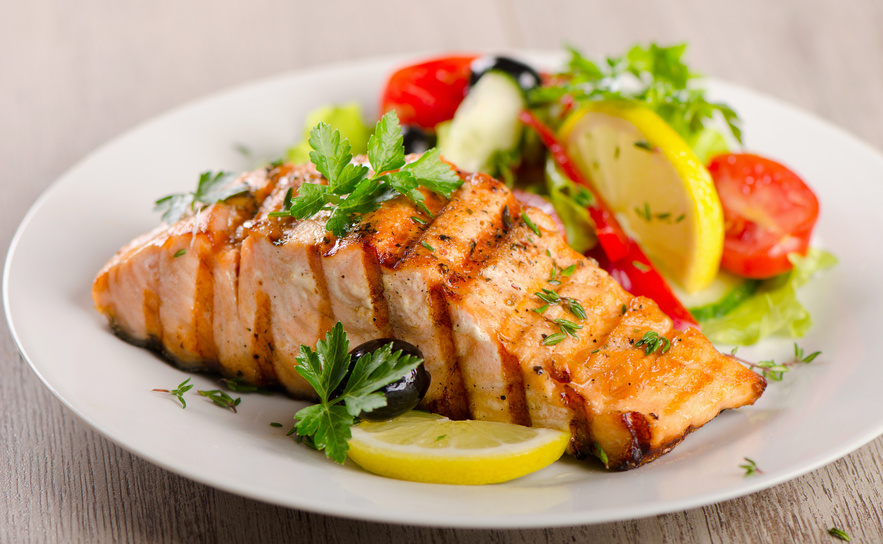Plate with grilled salmon and salad