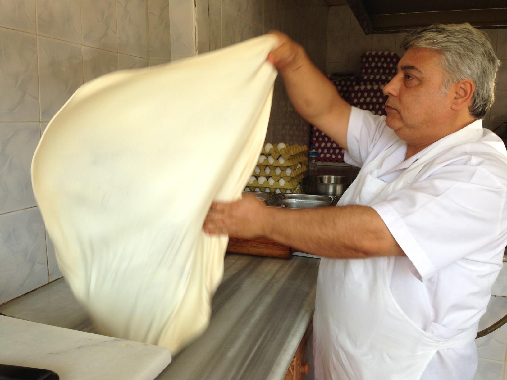 man prepares street food in turkey