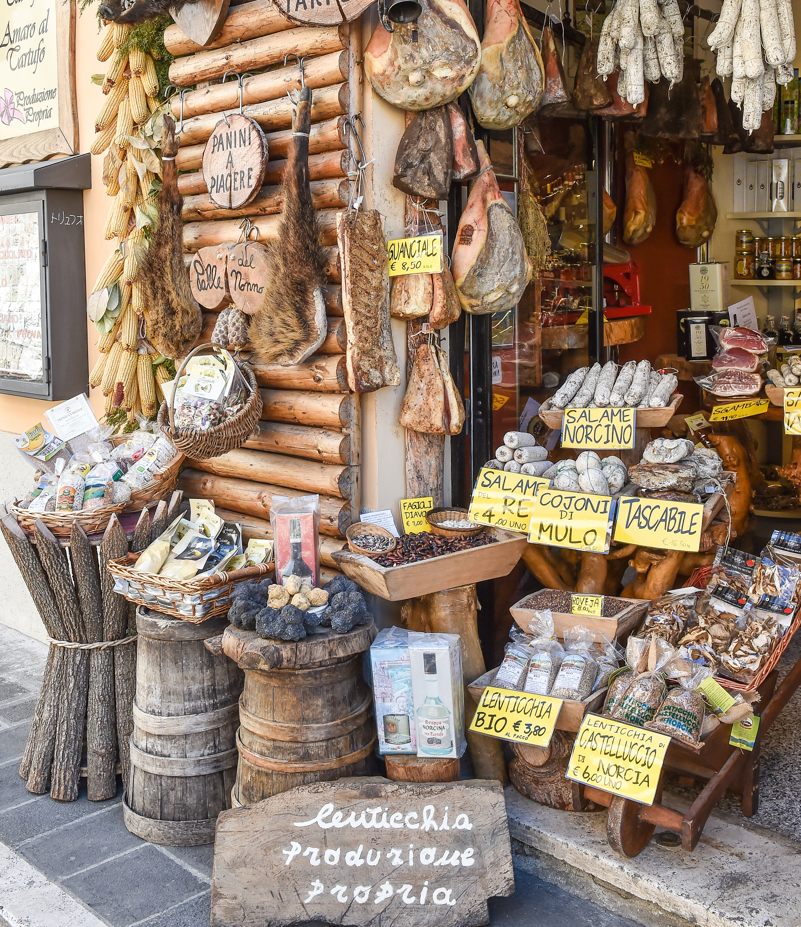 Market in Norcia, Umbria, Italy, with cured meats