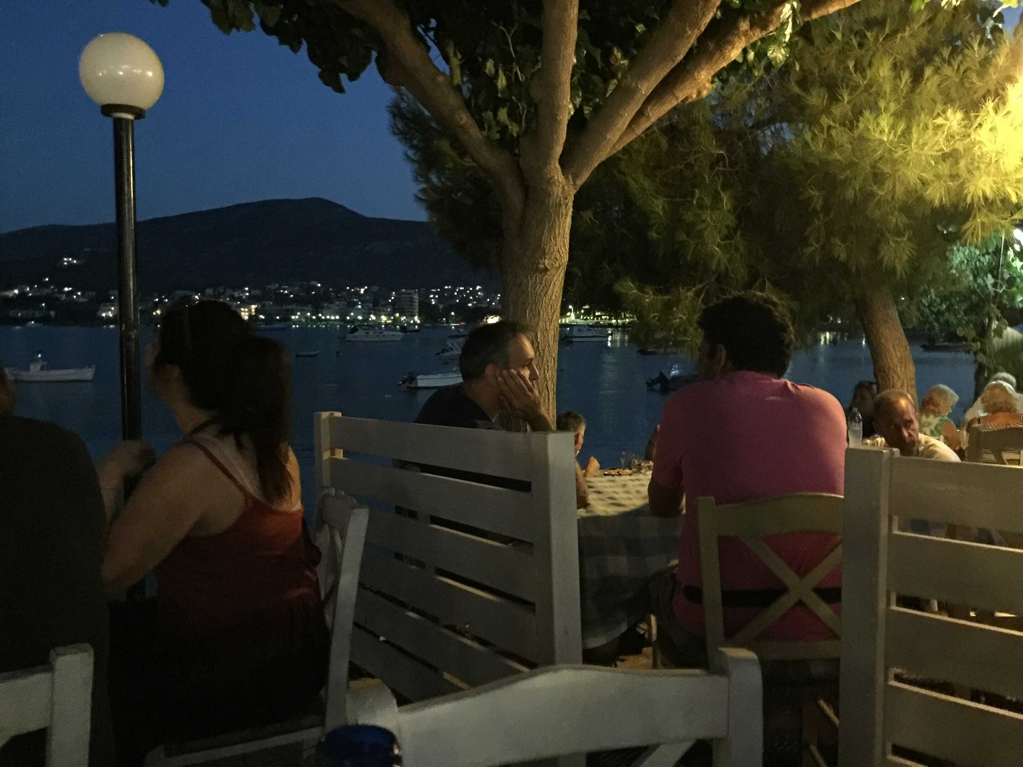 dining by the sea at night in greece