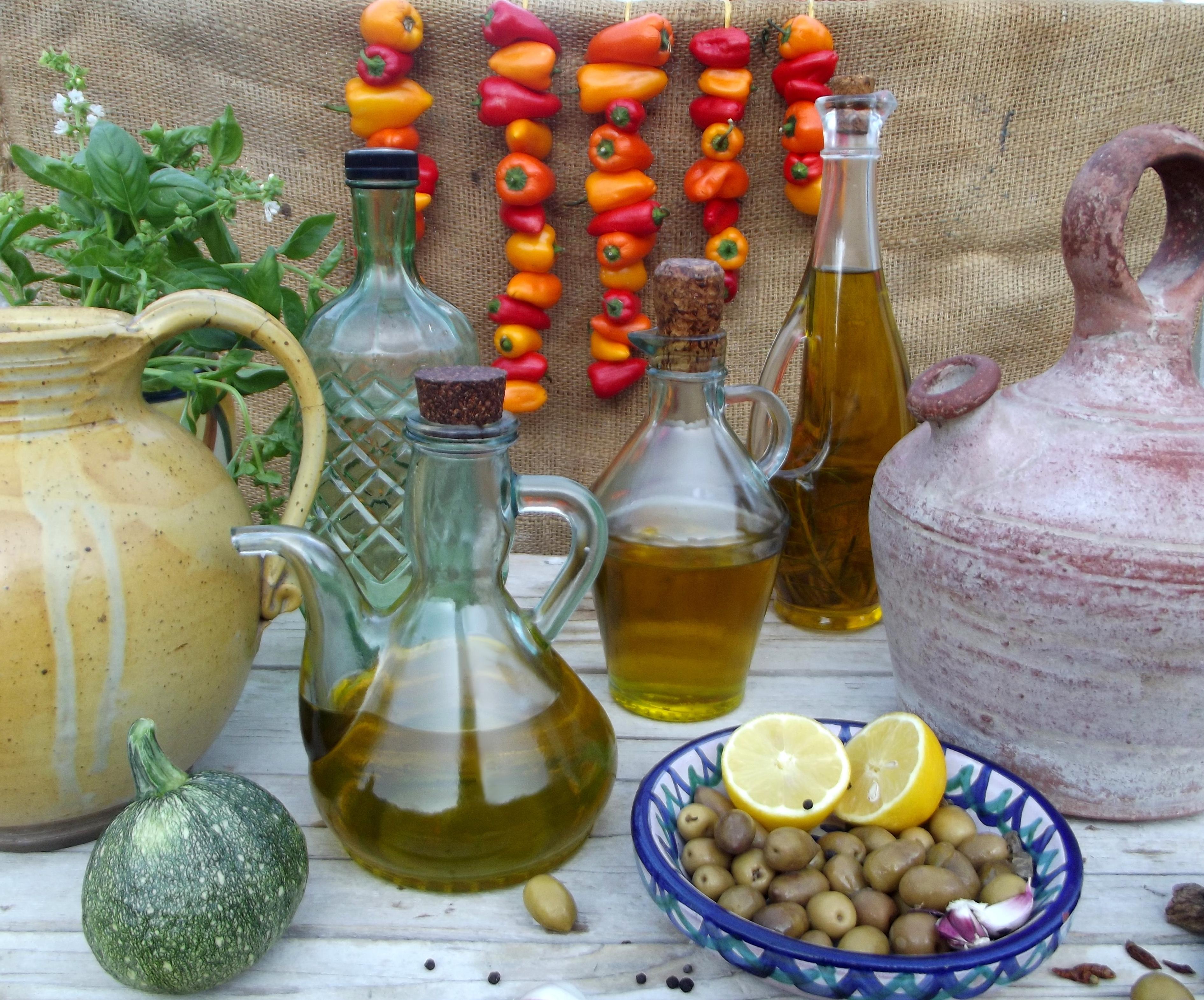 olive oil, olives and hanging vegetables