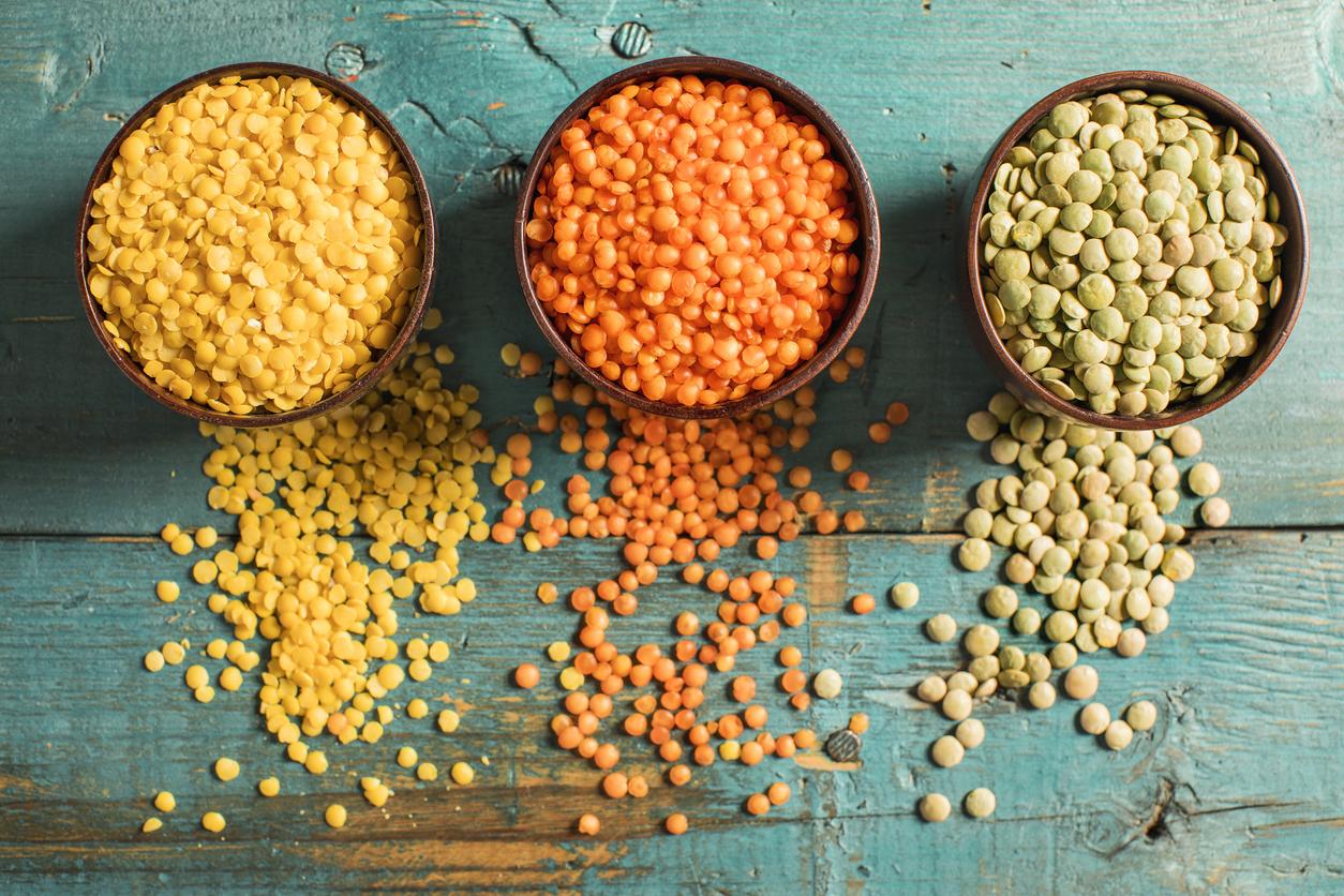 colorful lentils on blue wood