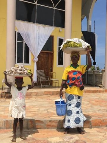 mother and daughter selling boiled groundnuts and bananas .jpg